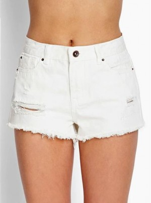 Short de jean blanco roturas