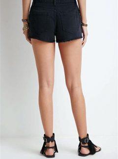 Short de jean negro desflecado Tiro alto. Inquieta. SH182