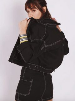 Campera de jean negra costura blanca inquieta